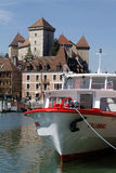 Castle and cruise boat in Annecy Royalty Free Stock Images