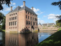 Castle in Denmark. Surrounded by water Royalty Free Stock Image