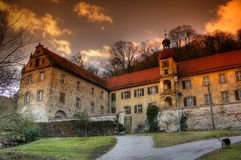 Castle with dog. An old castle in Bavaria with a dog stock image
