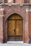 Castle door. Photo of a wooden reinforced castle door Royalty Free Stock Photos