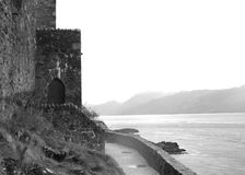 Castle Door at Eilean Donan. Castle door on the Loch side of the ancient Castle Eilean Donan in Scotland Stock Images
