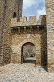 Castle doorway in Elvas, Alantejo, Portugal. Elvas medieval  entrance to castle with cobblestone arched walkway in Alantejo, Portugal Royalty Free Stock Photos