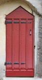 Castle Doorway. Old red door on a masonry building Stock Image