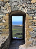 Castle doorway and stone frame. Castle doorway at Harlech castle, wales. View through to the sea Stock Photography