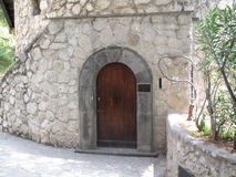 Castle Doorway. Wooden Round-top Door and Arch in Stone Wall in Daytime Royalty Free Stock Photo