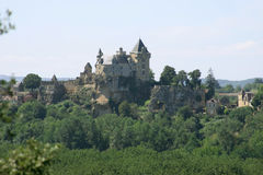 Castle in the Dordogne in France. French Castle on a hill in the Dordogne Royalty Free Stock Photos
