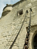Castle with drawbridge chains. Castle detail with drawbridge chains in foreground Royalty Free Stock Photography