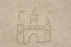 Castle drawing in sand. Background stock image