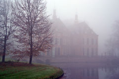 Castle Duivenvoorde in the fog. Stock Photos