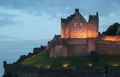 Castle at Dusk. A castle atop a hill dramatically lit at dusk royalty free stock photography