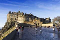 Castle of Edinburgh, United Kingdom. Edinburgh, United Kingdom - December 1, 2013: Several tourists in front of the main entrance of the castle of Edinburgh Royalty Free Stock Photos