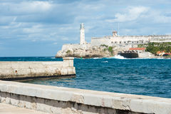 The castle of El Morro and Malecon wall in Havana Royalty Free Stock Photos