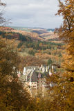 Castle Eltz Germany. The Castle Eltz in the Mozel region in Germany, seen though the trees in Autumn royalty free stock image