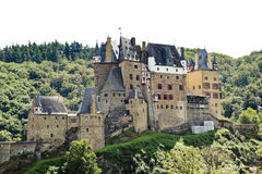 Castle Eltz on green hill above Mosel river Royalty Free Stock Images
