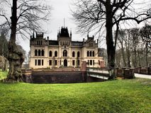 The castle evenburg in the german City Leer. The Castle evenburg and an old church in the german City of leer Royalty Free Stock Images