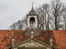 The castle evenburg in the german City Leer. The Castle evenburg and an old church in the german City of leer Royalty Free Stock Photography