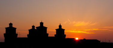 Castle of Ferrara backlit at sunrise Royalty Free Stock Photo