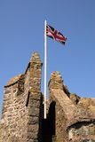 Castle and Flag. The British flag flies over Pembroke Castle in southwest Wales Stock Image