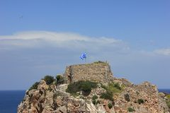 Castle with flag. Ancient Greek castle with flag Stock Photography
