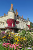 Castle and flower garden Stock Images