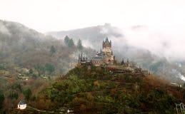 Castle in the fog Stock Photos