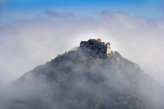 Castle in the fog Stock Photography