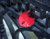 Castle in form of heart hanging on fence Royalty Free Stock Photography