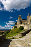Castle fortress of carcassonne, france. View on famous medieval fortress castle rising up in blue sky in sunset light, carcassone, south france Royalty Free Stock Image
