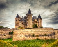 Enchanted Castle in France. Architectural details of aging historic Chateau de Saumur castle in the Loire Valley of France on a grey cloudy day. This is a HDR Royalty Free Stock Photos