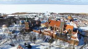 Castle of Frombork in Poland. Aerial: Castle of Frombork in Poland at winter time stock video footage