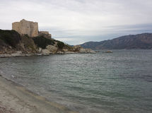 A Castle in front of the sea in a cloudy day. In Villasimius royalty free stock photography