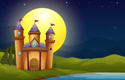 A castle in a full moon scenery Stock Photos