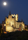 Castle and full moon in Segovia. Alcazar. Royalty Free Stock Photography