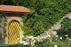 Castle Garden Doorway. Simple and yet very beautiful garden passage at the Heidegg castle in Switzerland Royalty Free Stock Photo
