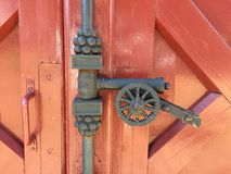 Gate style. Castle gate has cannon shaped closer stock photography