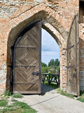 CAstle gateway. Massive wooden door of a medieval castle Royalty Free Stock Photography