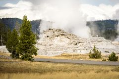 Castle Geyser on the Upper Geyser Basin next to Old Faithful at Yellowstone National Park Royalty Free Stock Photos