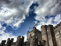 Castle Ghent. Clouds. Flags. Stones royalty free stock photography
