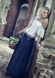 Castle maid with basket Royalty Free Stock Image