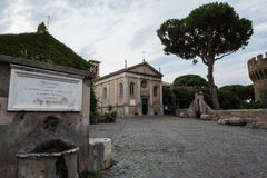 Castle of Giulio II in Ostia Antica Rome and Church. Castle of Giulio II in Ostia Antica Rome near archeological Site near the sea Stock Photos