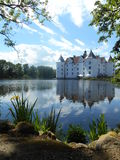 Castle in Glücksburg in Germany. Castle by the sea in Glücksburg in Germany. The Castle is mirroring in the sea . Clouds are mirroring. plants, trees, water Royalty Free Stock Photography