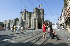 Castle Gravensteen and city life of Flemisch town of Ghent in Be stock photography