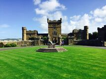 Castle on green lawn Royalty Free Stock Photo