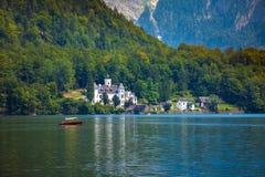 Castle on Hallstatt lake shore Stock Photos