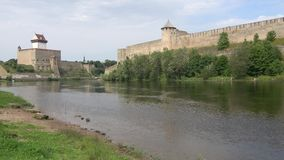 The castle Herman and Ivangorod fortress on the banks of the Narva river. The border of Estonia and Russia stock footage