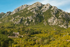 Castle hide in Montenegro mountains, view to sea and rocky green. Hills, balkan Stock Photo