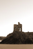 Castle on a high cliff in sepia Stock Photos