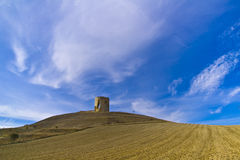 Castle hill. Behind a plowed field, in Castile, Spain Royalty Free Stock Images