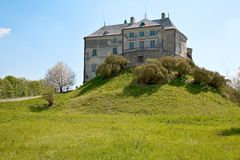 Castle on the Hill. Under blue sky Stock Image