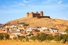 Castle on hill, Castillo de La Calahorra and village, Granada, A Royalty Free Stock Photo